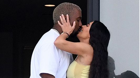 Kim Kardashian And Kanye West Share Steamy Smooch At The Condo He Bought Her For Christmas