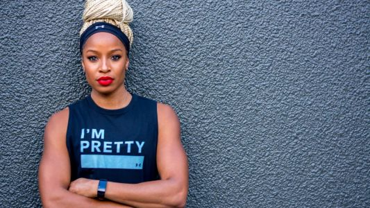 """Olympian Natasha Hastings Says Protecting Black Women In Sports Means """"Protect Our Peace"""""""