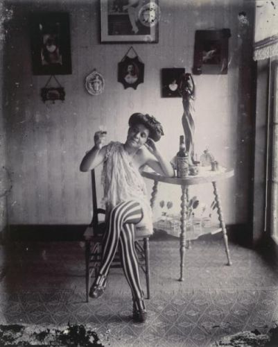 Woman with striped stockings by E.J. Bellocq, c.1912 from