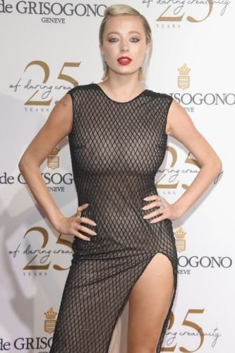 Caroline Vreeland stuns in a black embroidered dress with a high