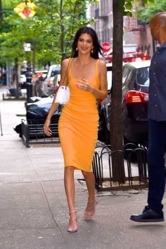 Kendall Jenner Hits the Town in NYC Rocking a Slinky, Tangerine Dress - See Photos!