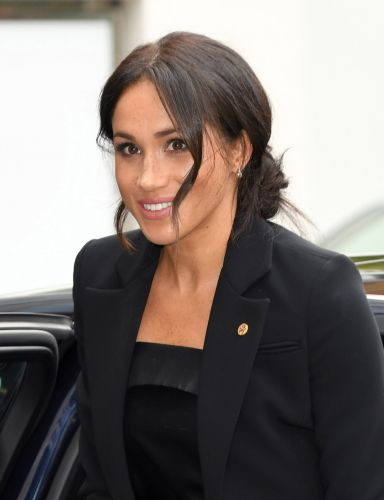 There's A Reason You'll Never See Meghan Markle Rocking Red Lipstick