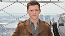 Tom Holland Saves Fan From Being Crushed By Autograph Seekers