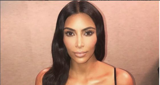 A Bikini-Clad Kim Kardashian Gets Distracted by Her Reflection - and We Don't Blame Her!