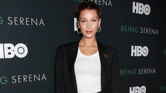 Bella Hadid's Suit-and-Sneakers Look Is What We Want to Wear Right Now