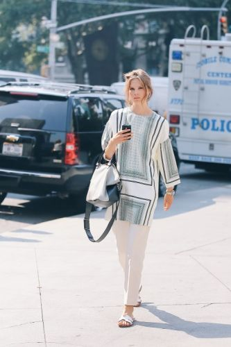 Pair tailored trousers with sliders and an oversized top to