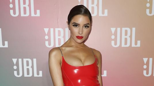 Olivia Culpo Flaunts Toned Body in Sideboob Baring Swimsuit