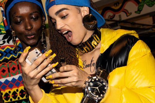 """""""Take the commute but make it fashion,"""" Claudia Croft Rides The Subway to Moschino's Pre-Fall 2020 Show"""