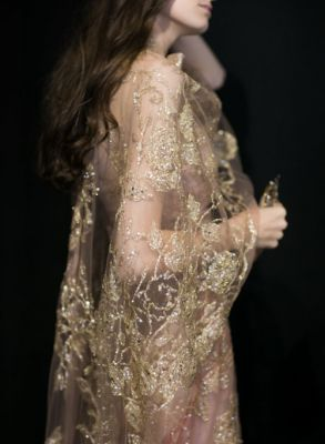 Like second skin gold embroidery delicately traces a