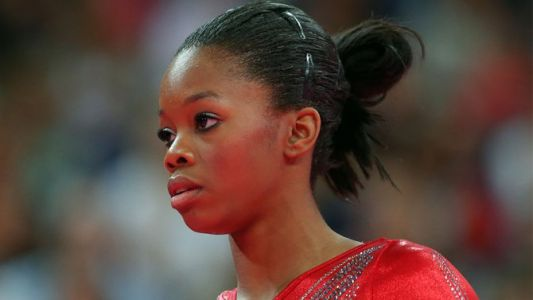 Simone Biles Claps Back at Trolls Commenting on Her Hair
