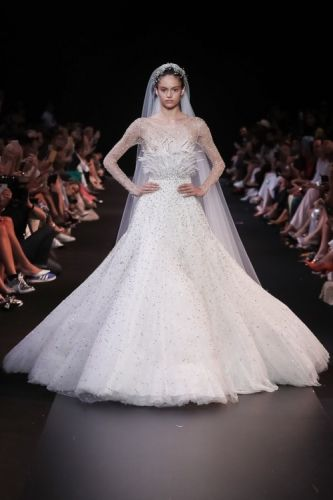 Exquisite bridal gown with an illusion, long sleeved top