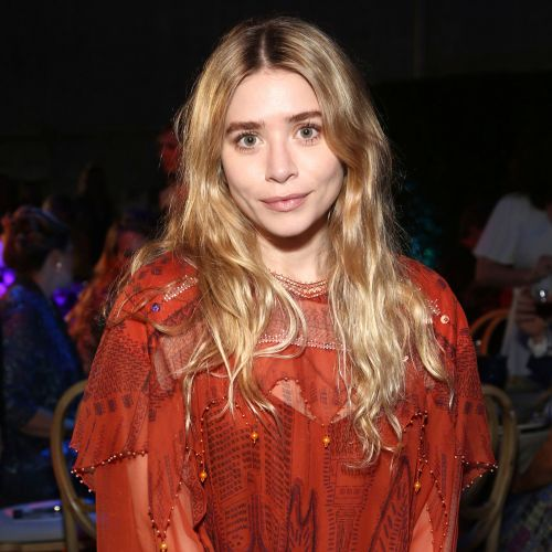 Ashley Olsen Spotted in a Sexy Bright Blue Blouse While Out With Friends in NYC