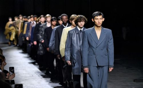 Dowdy no more: Men in suits storm back into style