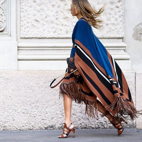 A fringed cape is the ultimate coverup for fall. Coordinate