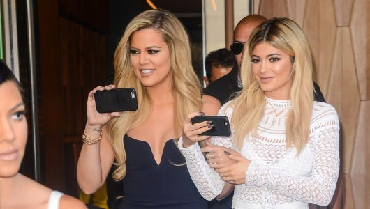 Khloé Kardashian And Kylie Jenner Are Totally Twinning In Recent Sparkly Holiday Pics