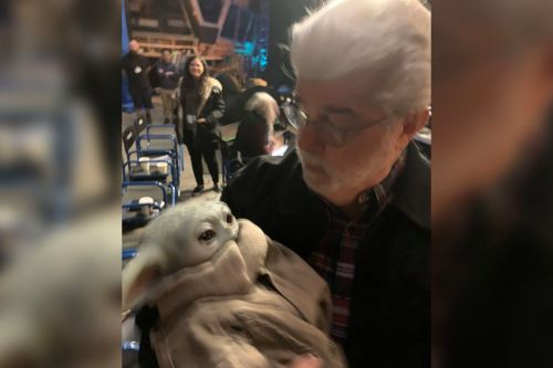 George Lucas meets, tenderly cradles Baby Yoda for 'Stars Wars' fans