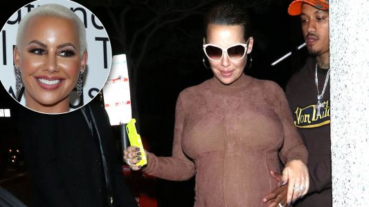 Amber Rose Shows Off Her Growing Baby Bump in Nude Heels and Form-Fitting Dress